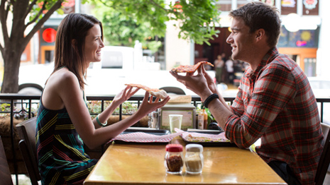 RedEye: Man and woman eating pizza at restaurant