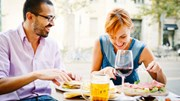 Dining: Man and woman eating and drinking