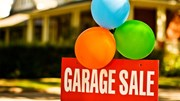 Garage Sale: Garage Sales sign with balloons in front of house