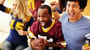 Sports: People cheering at a football game