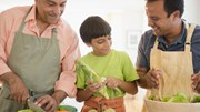 Good Eating: 2 men and child cooking in kitchen