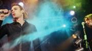 Metromix.com: Man singing at concert
