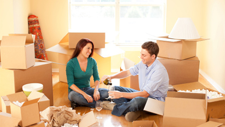 Apartment Home Rentals: Man and Woman unpacking in house